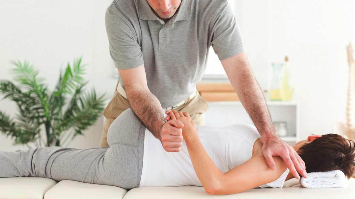 man/woman getting exam from chiropractor